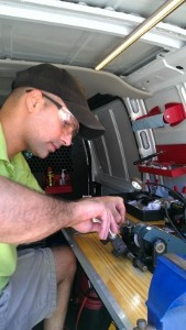Our Cincinnati locksmith is cutting keys in his truck for one of our clients.