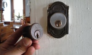 The new mortise lock installed on the door next to the old one by our Cincinnati locksmith Eagle's team.
