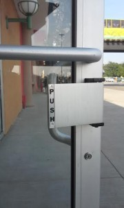 This is the paddle handle on the inside of the door for customers to exit with an easy push.