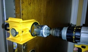 Drilling a pip hole for a new lock installation by Eagle's Locksmith Cincinnati